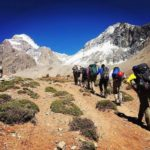 Trekkers enjoying the comfort of approach shoes en-route to Aconcagua Base Camp.
